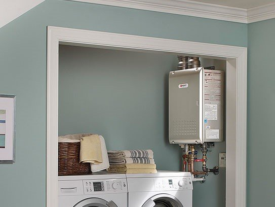 Tankless water heater installed in laundry room